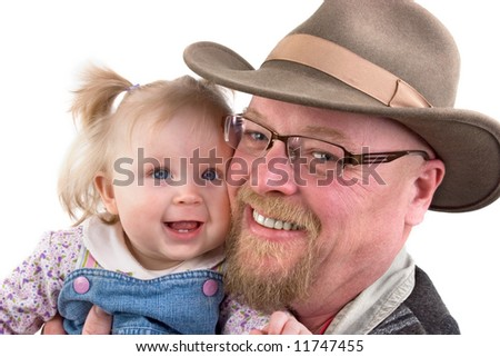 A cute baby girl and her grandfather - stock photo