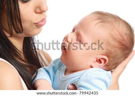A cute baby lying on his mother's shoulder, isolated on white - stock photo