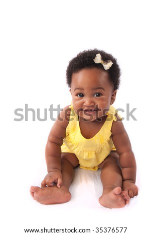 a cute baby poses in front of a white background