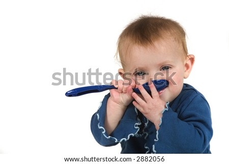 A cute baby with a blue spoon on a white background