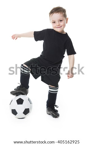 A Cute boy is holding a football ball isolated on a white background. Soccer
