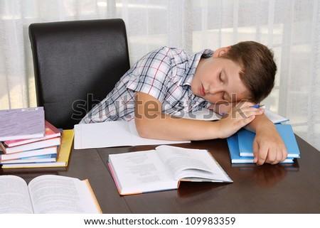 A cute boy sleeping on a books - stock photo