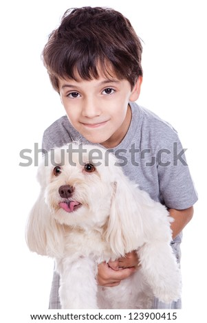 A cute boy with his white dog isolated on white background. - stock photo
