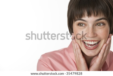 A cute brunette posing with a surprised expression on her face.  Horizontally framed shot.