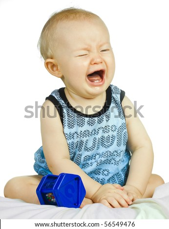 A cute but very upset baby boy crying. - stock photo