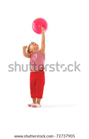 a cute child playing with a balloon - stock photo