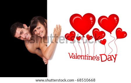 A cute couple behind a white wall, valentine's day theme - stock photo
