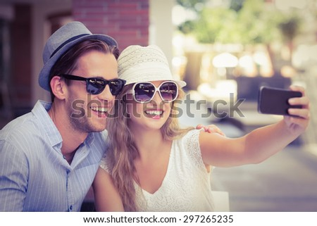A cute couple taking a selfie with a smartphone