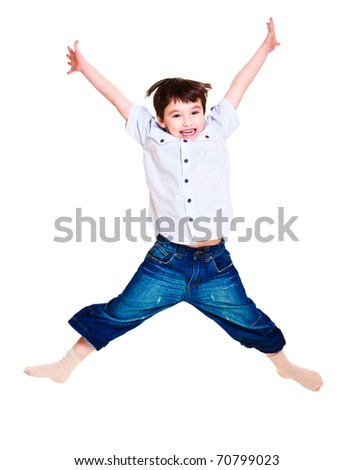 A cute excited boy jumping - stock photo