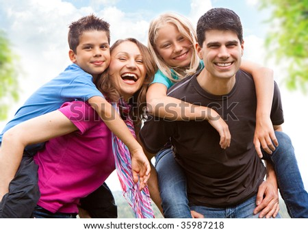 a cute family in the nature - stock photo