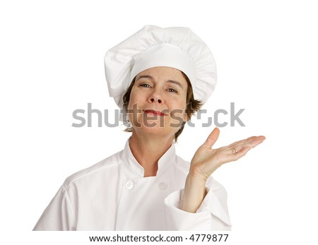 A cute female chef waving her hand in a gesture of presentation.  Isolated on white.