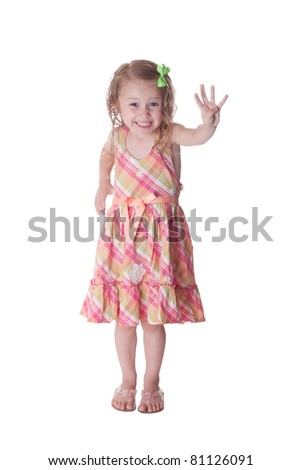 A cute girl hold up four fingers to show that she is four years old.  This image is isolated on white.