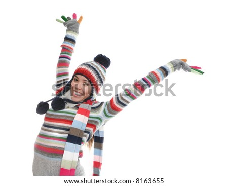 A cute girl in winter clothes over a white background - stock photo