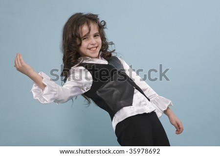 A cute girl posing on a blue studio background
