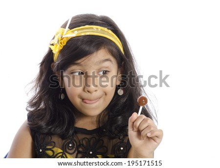 A cute girl showing her lollipop - stock photo