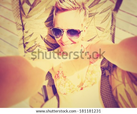 a cute girl smiling at the camera on a bright sunny day done wit - stock photo