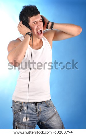 a cute guy with headphones - stock photo