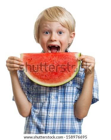 A cute happy smiling boy about to take a bite of  juicy slice of watermelon. Isolated on white.