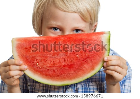 A cute happy smiling boy holding a big juicy slice of watermelon. Isolated on white.