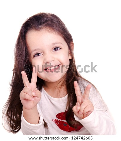 A cute kid girl making victory sign with her hands. This sign is also known as peace and love. The infant girl is isolated on white. - stock photo