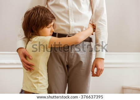 A cute little boy hugging his father, cropped - stock photo