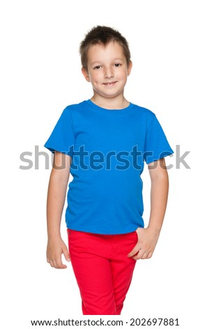 A cute little boy in the blue shirt is walking on the white background