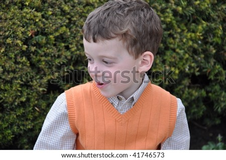 a cute little boy making faces - stock photo