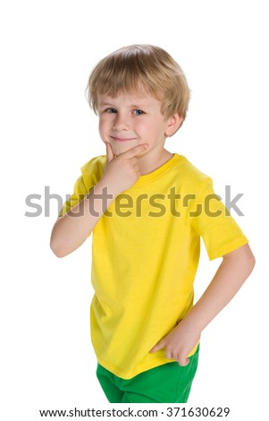 A cute little boy thinks on the white background - stock photo