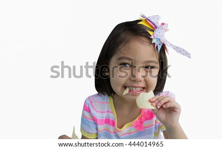 A cute little girl eating chips isolated  on white background - stock photo