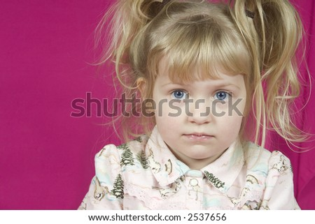 A cute little girl looking a little thoughtful