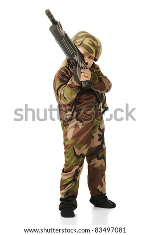 A cute little girl taking aim with a toy machine gun while playing soldier.  Isolated. - stock photo