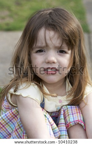 a cute little girl that is upset - stock photo