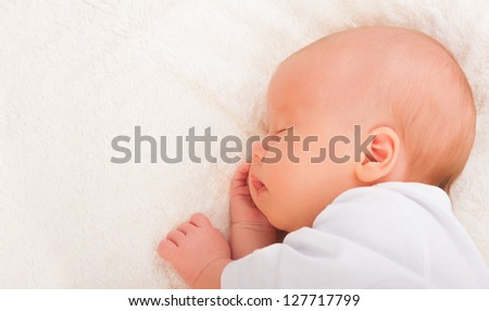 A cute newborn baby sleeps, rests - stock photo