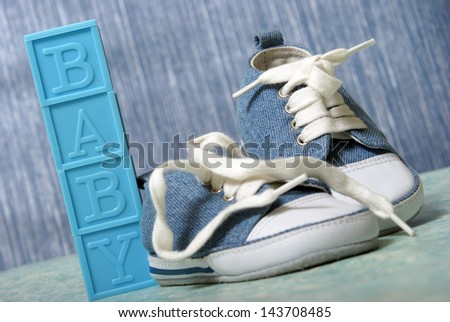 A cute pair of denim baby shoes for the young boy. - stock photo