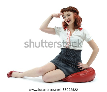 A cute pin up girl giving a salute. - stock photo