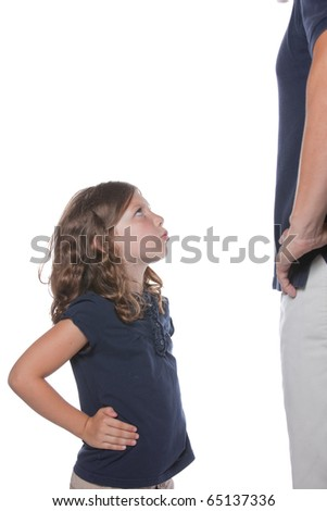 A cute sassy little girl shows she is upset during a conflict with her parent father - stock photo
