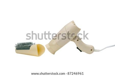 A cute small yellow hair dryer - stock photo