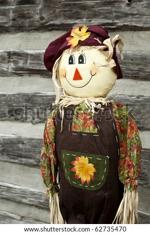 A cute smiling scarecrow, vertical with copy space - stock photo