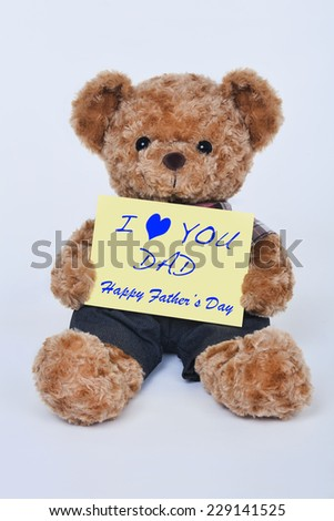 A cute teddy bear holding a yellow sign that says I love dad for Fathers Day isolated on a white background - stock photo