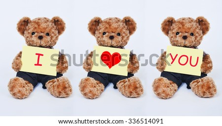 A cute teddy bear holding a yellow sign that says I Love You isolated on a white background - stock photo