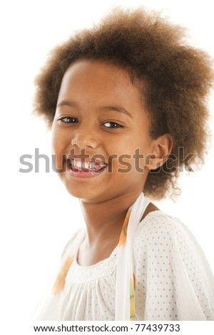 A cute 7 year old African girl in the studio against a white backdrop. - stock photo