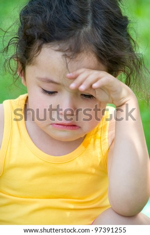 a cute 4 year old girl cries, closeup - stock photo