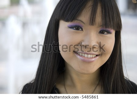 A cute young asian model with a great smile