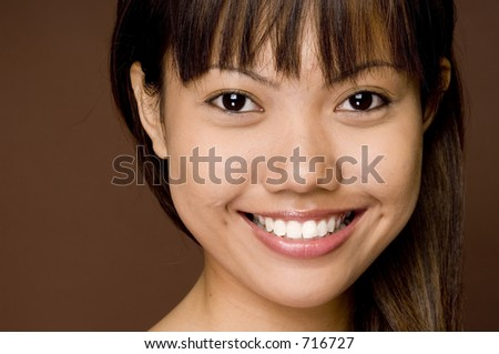 A cute young asian model with a great smile - stock photo