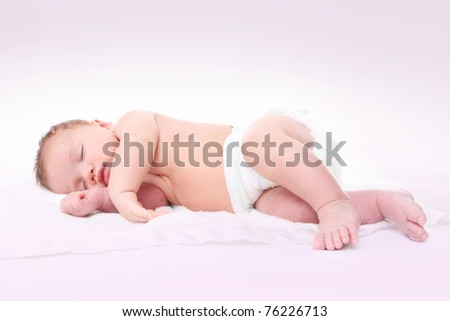A cute young baby  sleeping on a blanket - stock photo