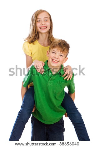 A cute young boy and girl playing. - stock photo