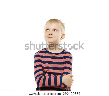 A cute young boy is thinking and looking up. Isolated on white background - stock photo