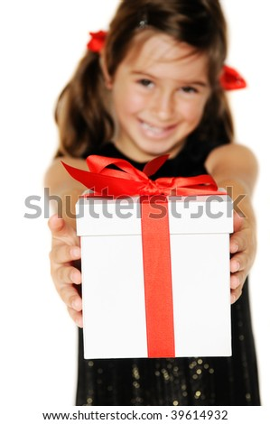 A cute young girl holding a christmas gift, shallow depth of field with focus on box