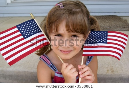 A cute young girl holding two usa flags - stock photo