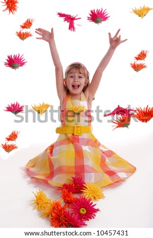 A cute young girl throwing flowers - stock photo